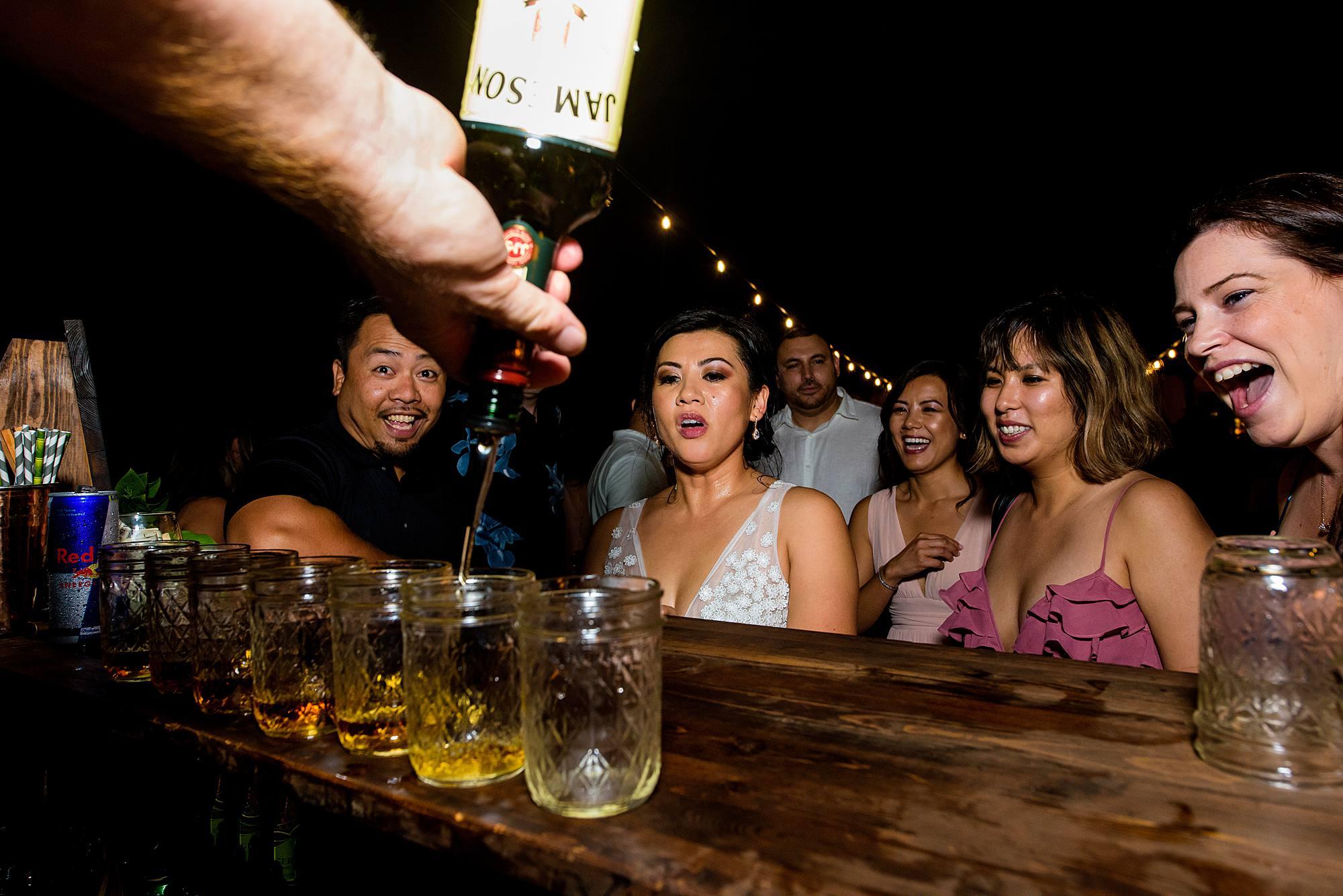 bride drinking jameson shots at her wedding