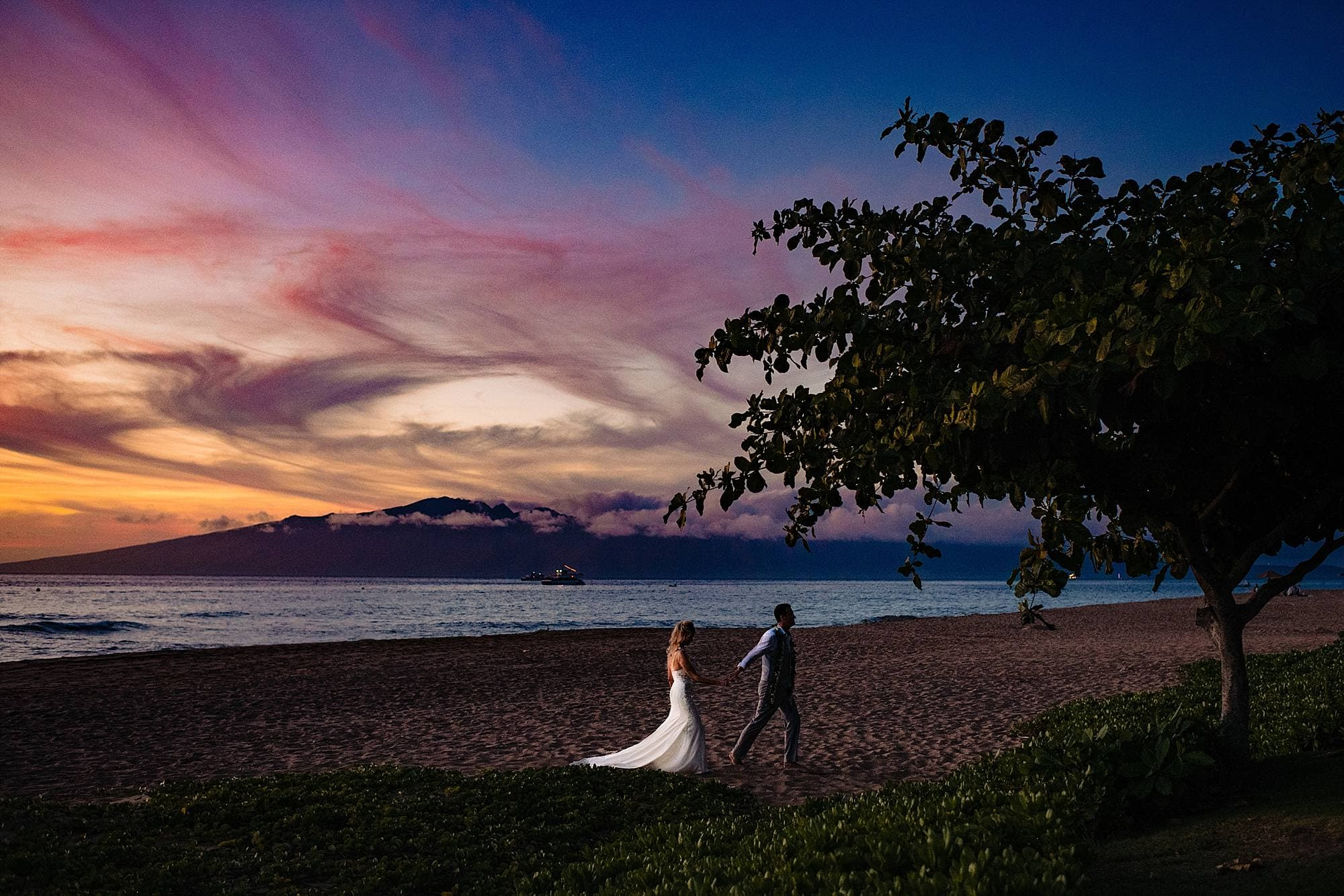 bride and groom at sunset in maui, hawaii