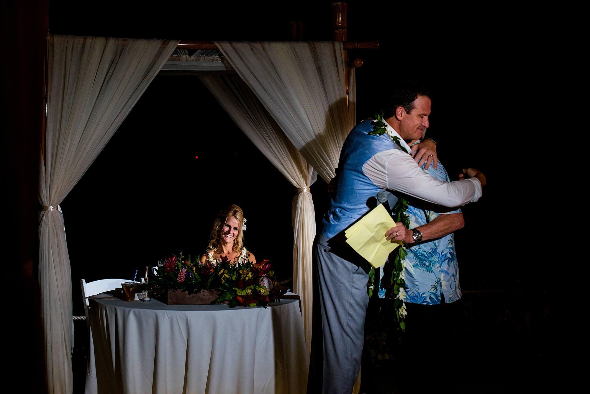 groom hugs dad after speech at westin maui