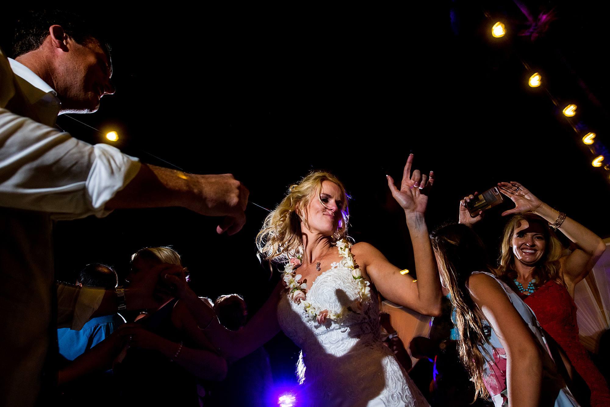 bride partying at her westin maui kaanapali reception