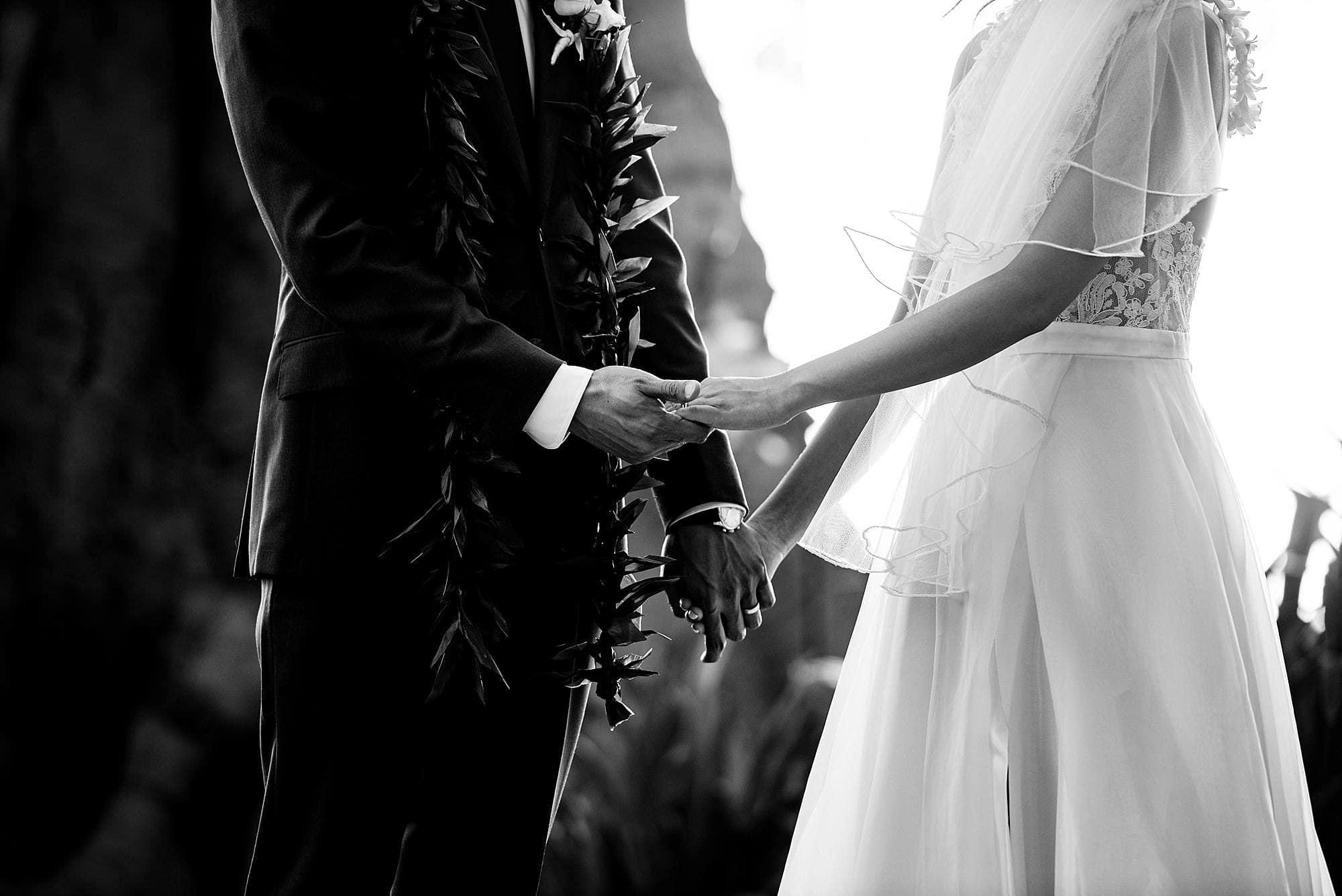 groom holding bride's hand at Olowalu Plantation House