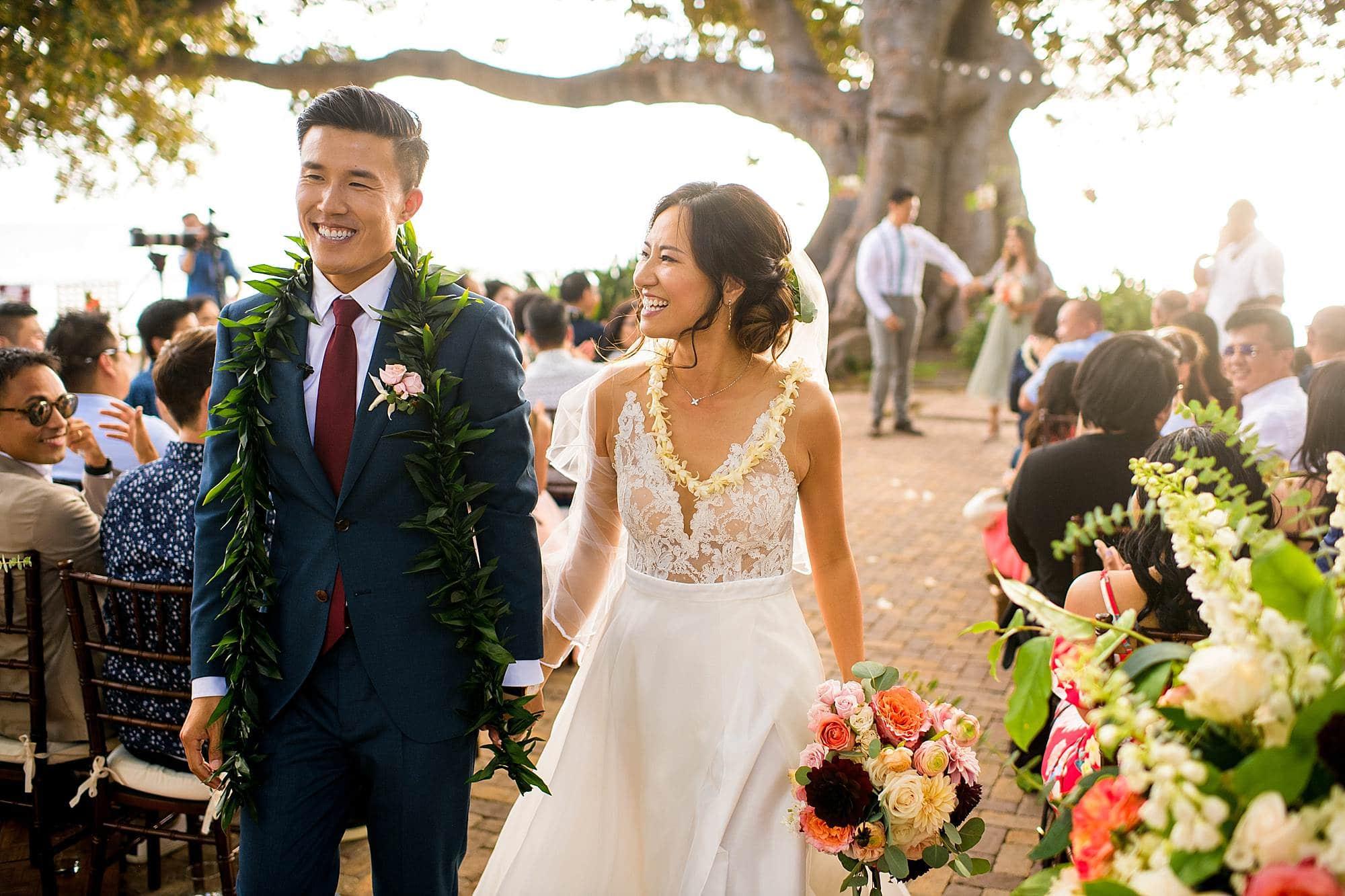 bride and groom walking back down aisle at Olowalu Plantation House