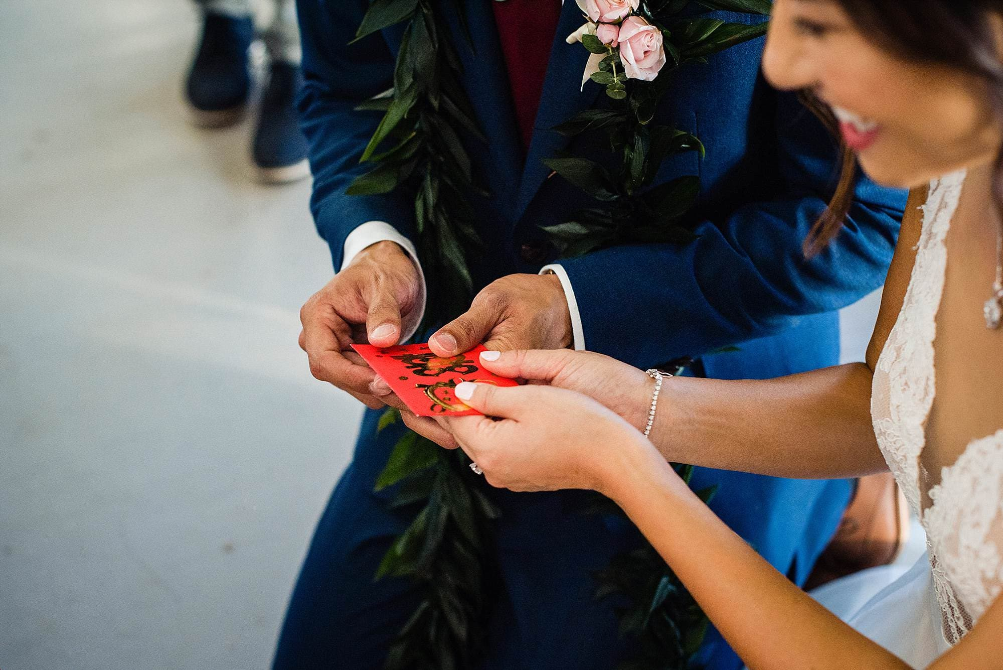 bride and groom receiving gift during tea ceremony