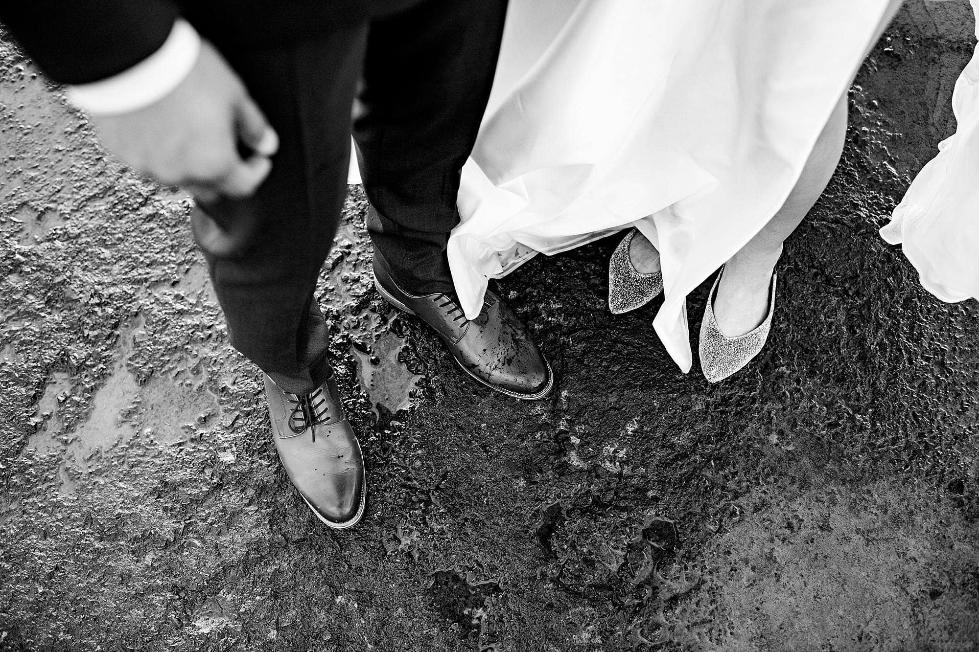 black and white photo of bride and groom's shoes at Olowalu Plantation House