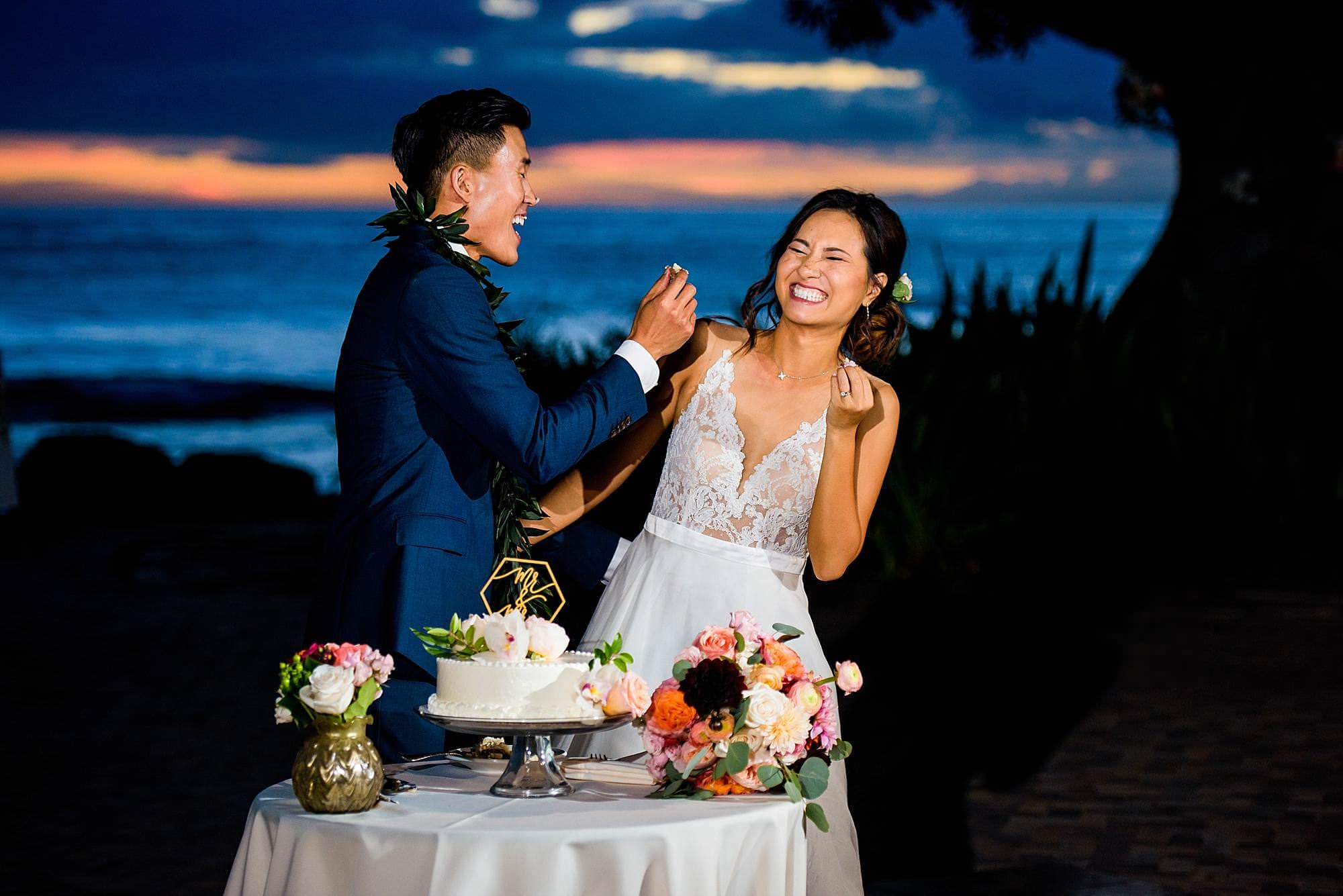 bride and groom cutting cake at Olowalu Plantation House