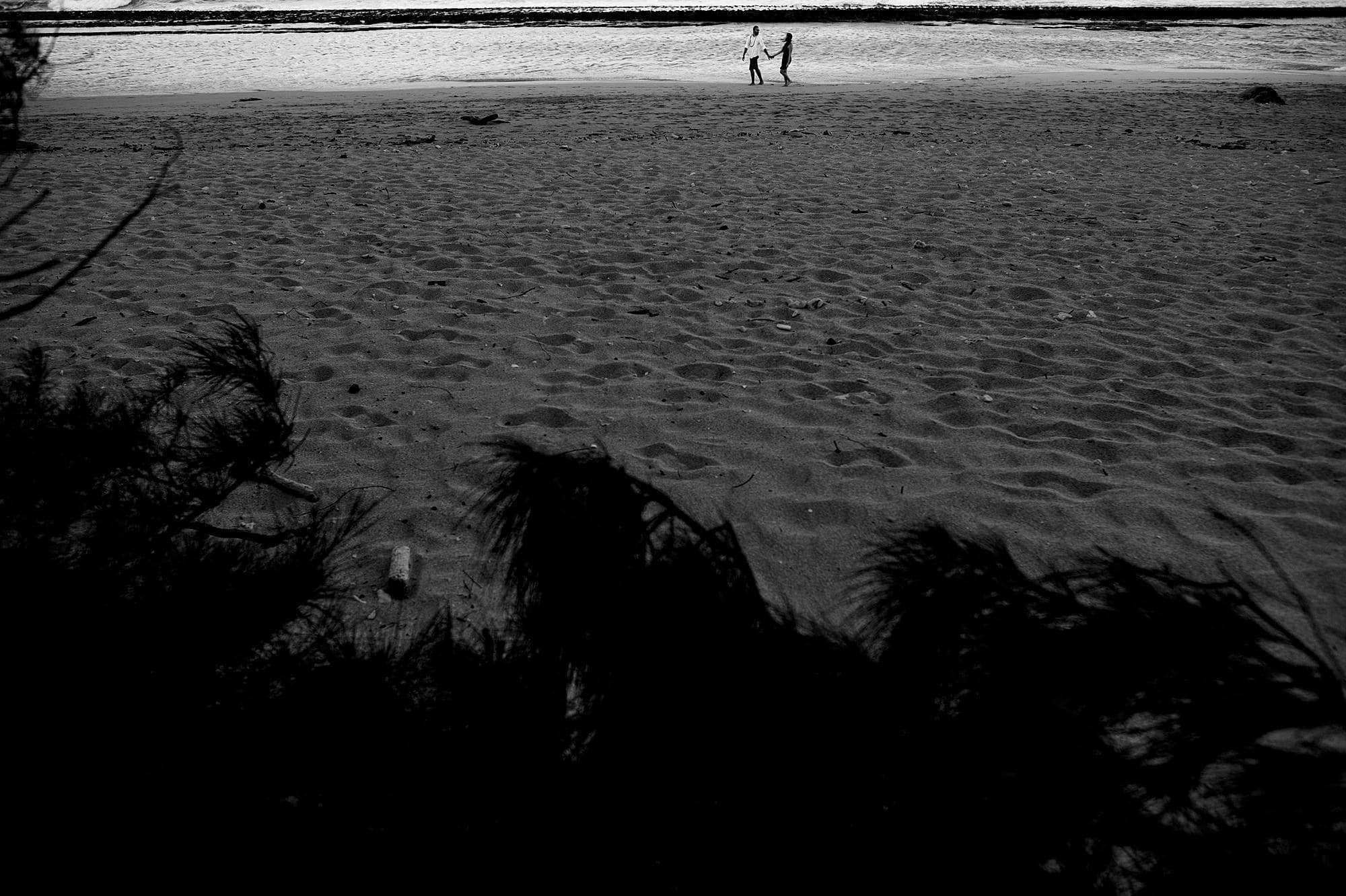 black and white photo on the beach in maui