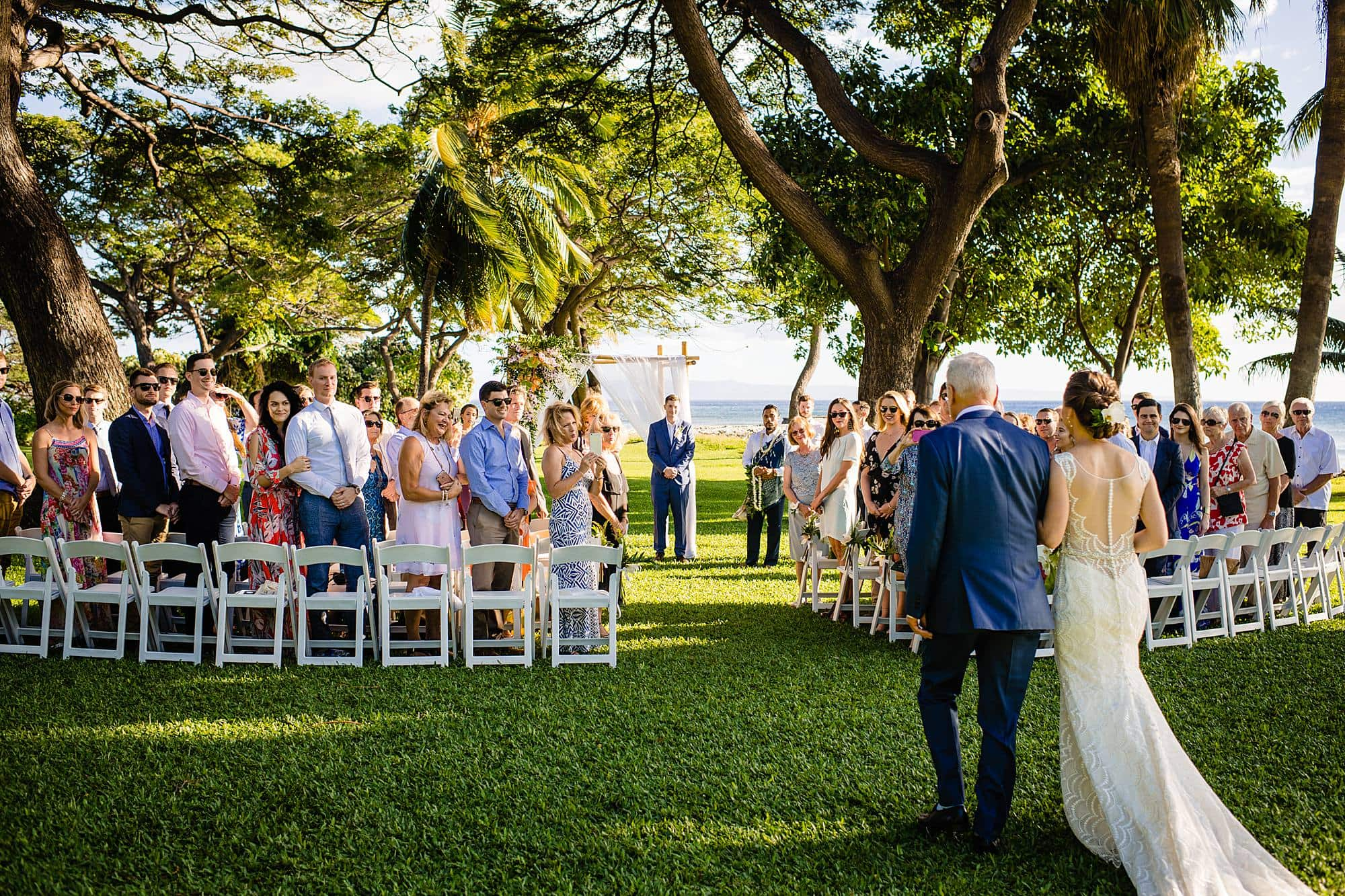 bride walking down aisle at olowalu plantation house