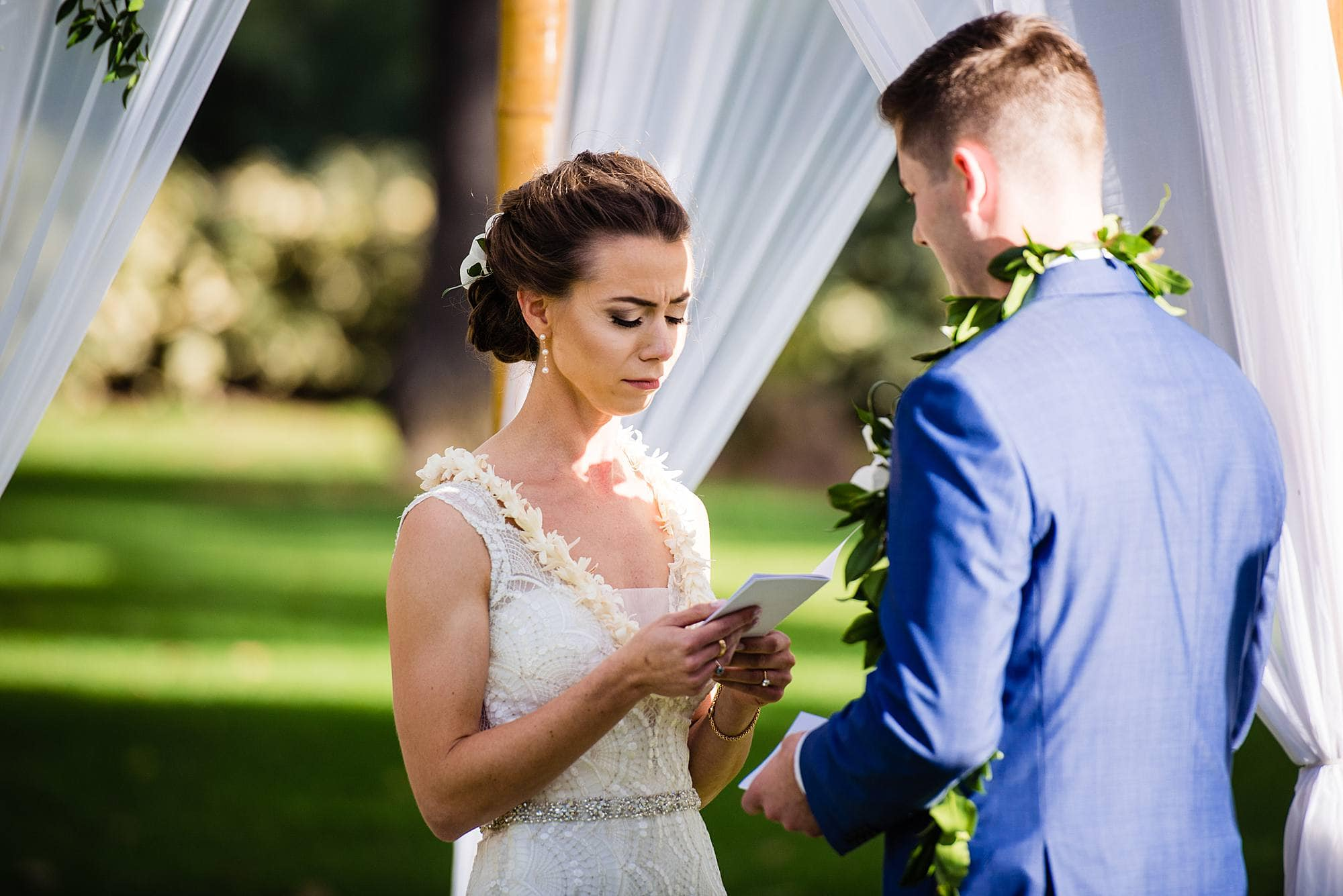 bride reading vows at olowalu plantation house
