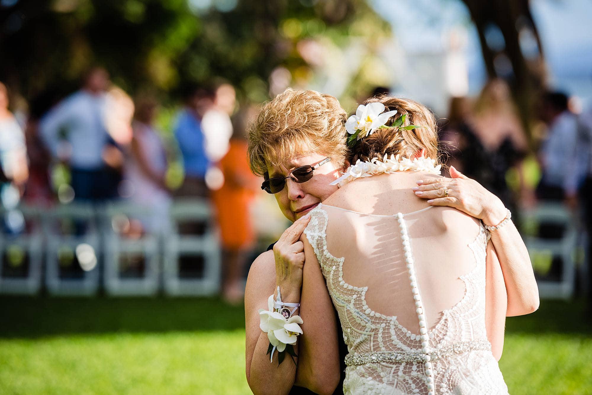 bride's mother embracing bride