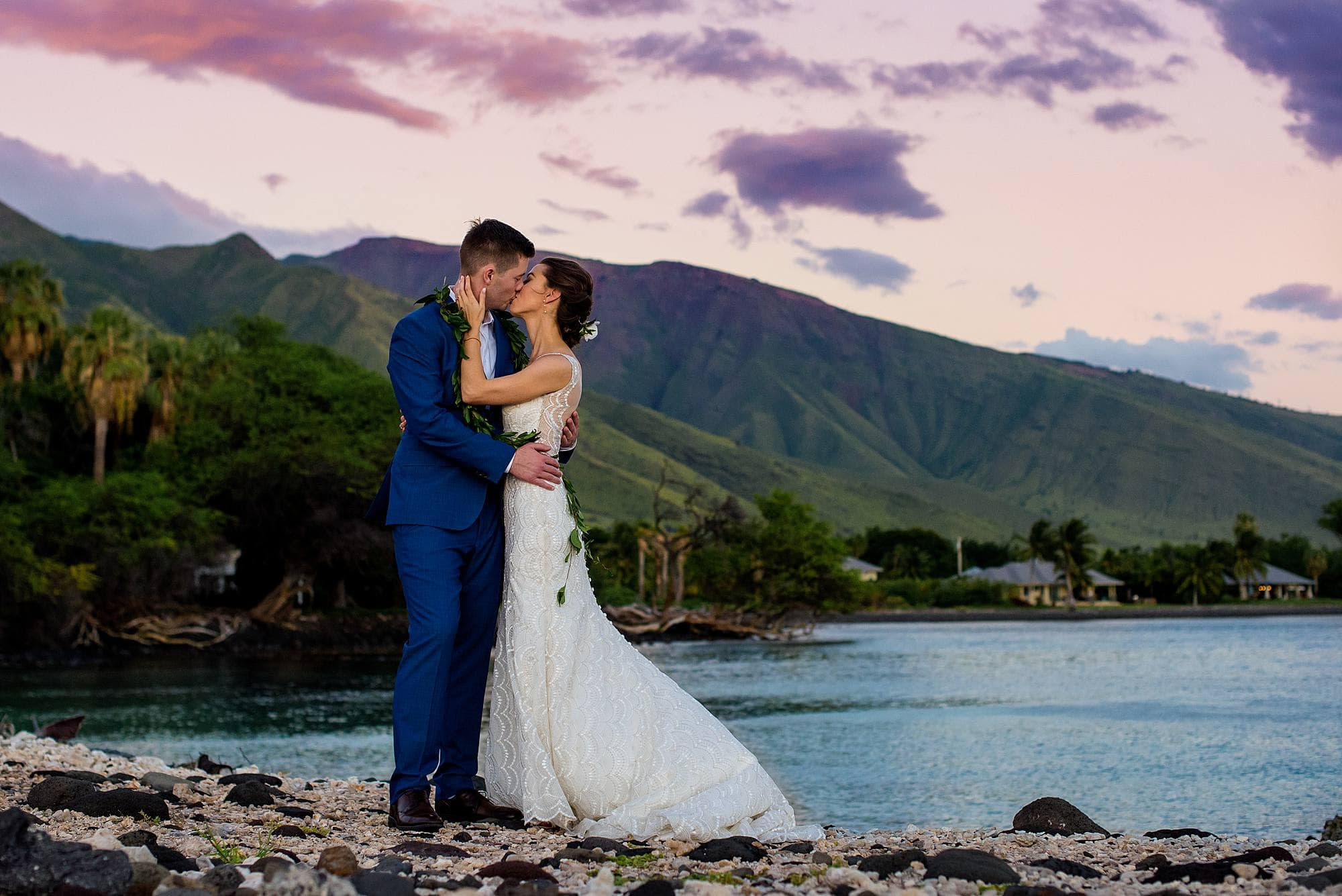 bride and groom kissing at olowalu plantation house pier