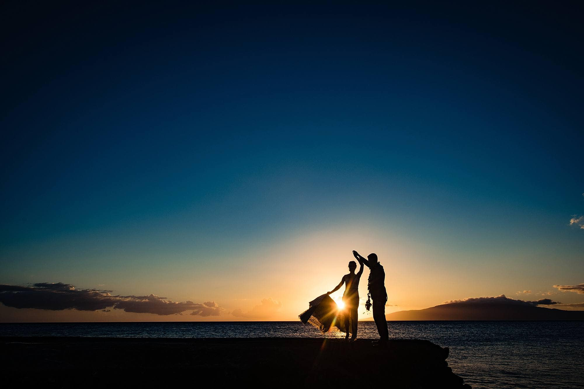 silhouette of couple at olowalu plantation house