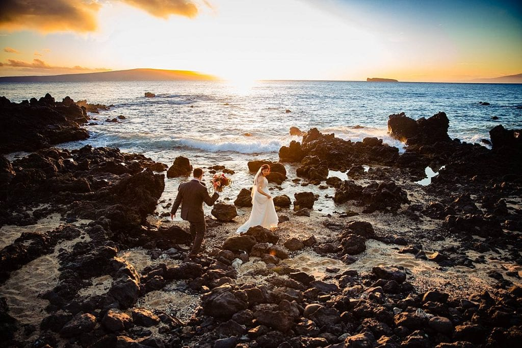 bride and groom portraits on rocks at white orchid beach house