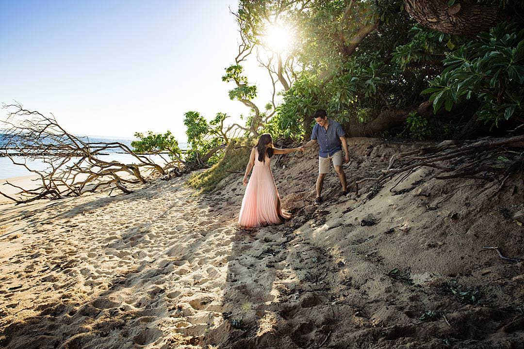 couple on the beach during their engagement session in maui